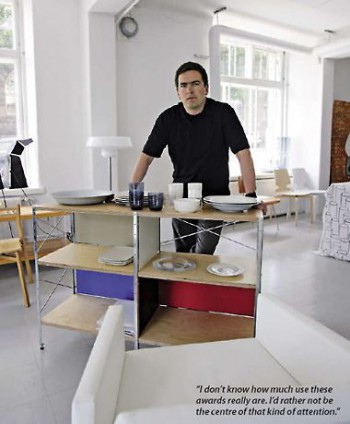 Designer Harri Koskinen poses with a few of his creations.
