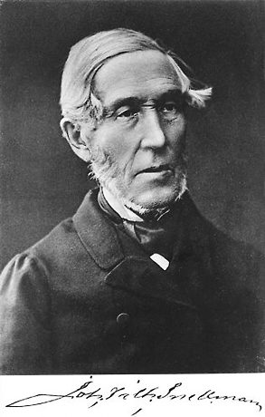 An antique black-and-white portrait photo of a man.