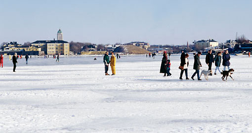Towns and cities are mainly small and low-rise, with no skyscrapers. In the winter the locals love to get out onto the frozen sea, as they are doing here outside Helsinki.