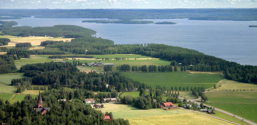 Key elements in Finland's varied landscapes include forests and open waters, often in a scenic interplay.