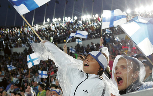 Spectators cheer at the World Athletics Championships at Helsinki's Olympic Stadium in August 2005.