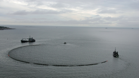 Closing the loop: Boats tow oil-containment equipment in HELCOM's oil-spill readiness drill on the Baltic Sea.