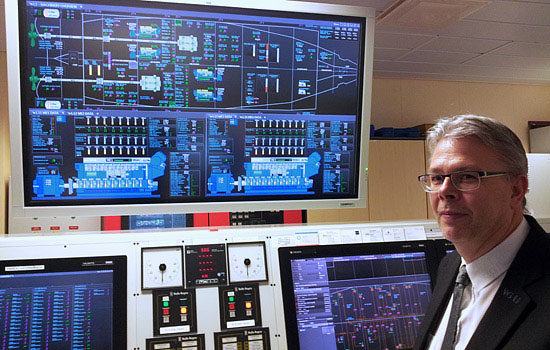 Chief engineer Henrik Fröberg explains the ship's energy management system in the control room.