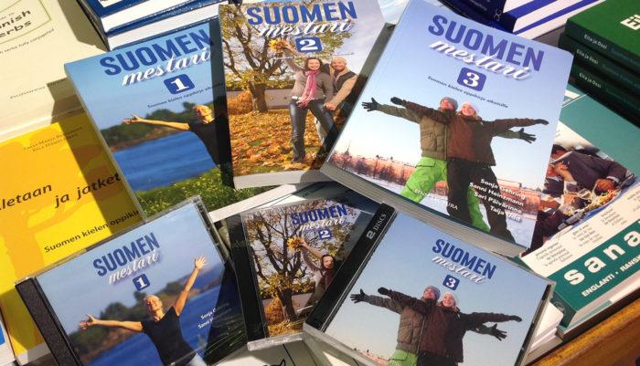 "A pile of ""Suomen mestari"" language books."