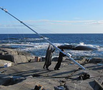 Researchers set up a mast that forms part of the new marine and atmospheric research station on the remote Finnish island of Utö.