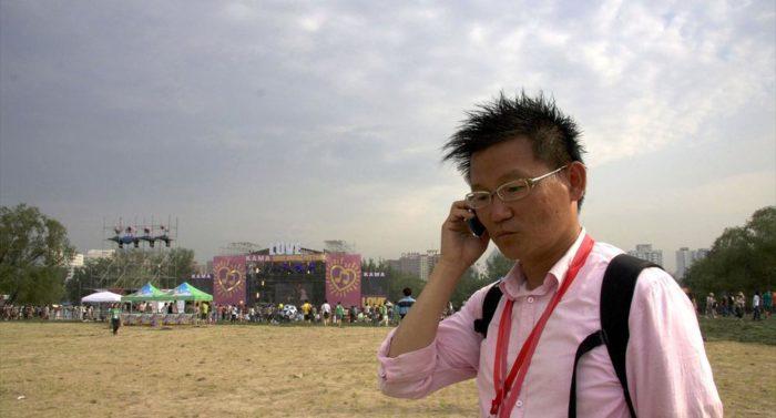 """正在北京KAMA爱·音乐节现场的张辉。他提到,""""分享的氛围""""是EARS成功的原因之一。"""