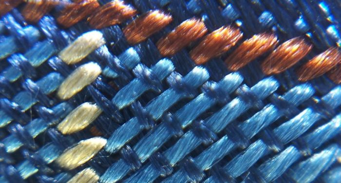 This microscope-magnified picture of a piece of fabric is taken with a regular mobile device using KeepLoop's mobile microscope.