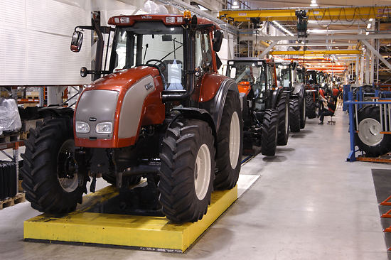 Tractors on an assembly line.