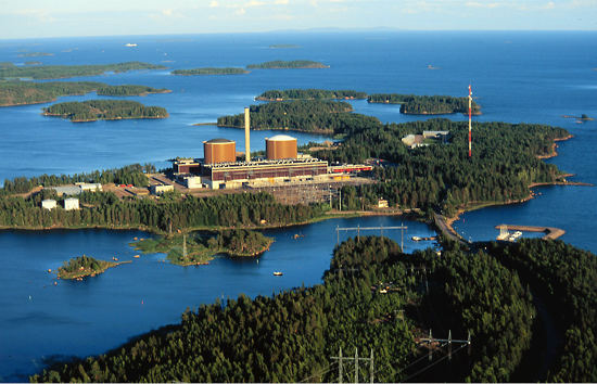 Nuclear power plant in a landscape with a lake and forested islands.