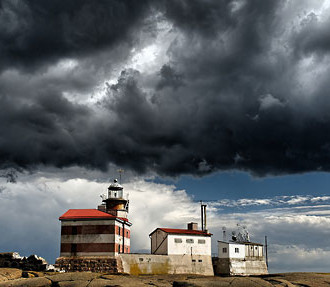 Dramatic cloud formations cross the sky above the lighthouse on Märket, a skerry in western Finland's autonomous Åland Islands.