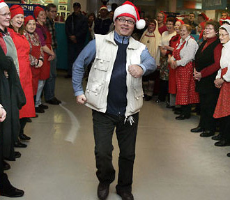 Heikki Hursti now runs the charity started by his late father. Here Heikki and his staff get in the Christmas spirit before the annual Hursti Christmas dinner event in Helsinki.