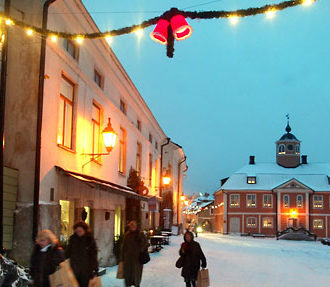Shoppers head home through the well-preserved old town in the southern Finnish city of Porvoo.