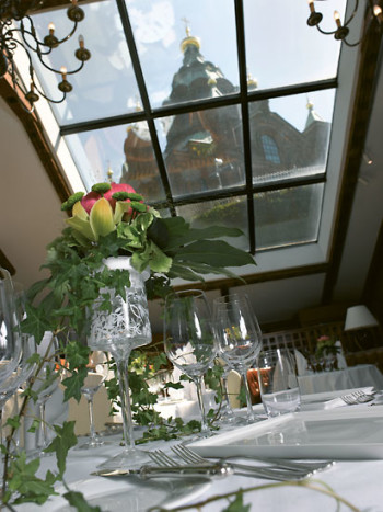 A classy set table; Uspenski Cathedral visible through the window.