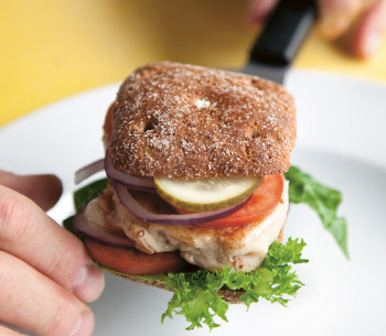 A chicken burger made with rye bread.