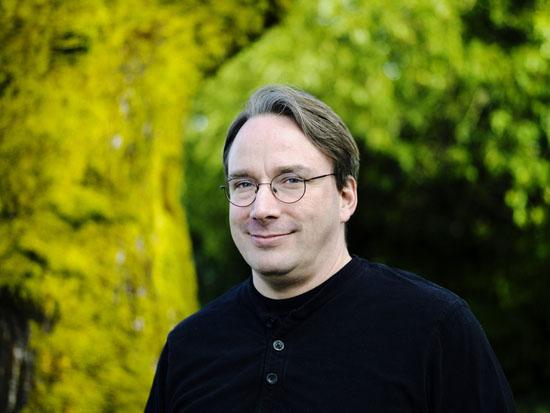 Portrait of a smiling Linus Torvalds.
