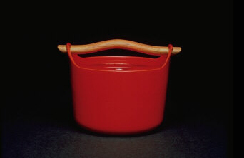 Cast iron pot red enamel coated with teak handle.