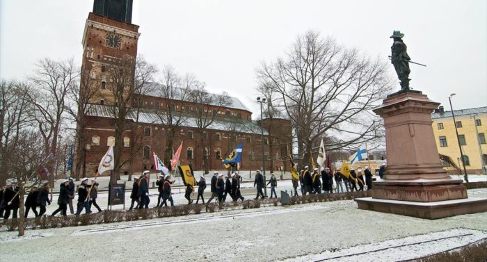 Traditions form an important part of student life: Student associations from Åbo Akademi University in Turku salute a statue of Per Brahe, founder of Finland's first university.