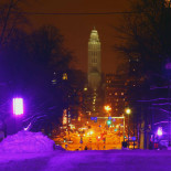 "From the top of a purple Unioninkatu (Union Street), you can see the ""natural"" streetlights and traffic lights in the neighbourhoods of Kaisaniemi and Hakaniemi, backed by the tower of Kallio Church."