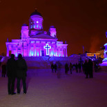 Purple to the people: Helsinki Cathedral forms the focal point of Mikki Kunttu's light show <i>Mercy</i>.