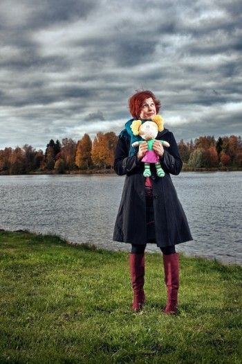 Niina Tuikkala holds a doll version of Hertta, who began in a cartoon show and now appears in online and mobile learning games.