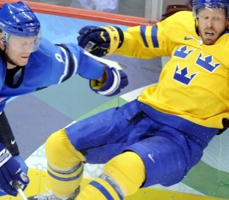 Swedish-speaking Finns are just as elated as Finnish speakers when Finland flies past Sweden at the Olympics. Here Mikko Koivu beats Sweden's Johan Franzén.