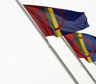 The national flag shared by Sámi people across northern Europe features the bright colours of traditional Sámi costumes, with red and blue halos signifying the sun and the moon.