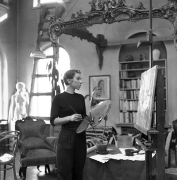 An artist from a family of artists: Tove Jansson painting at home in 1956.