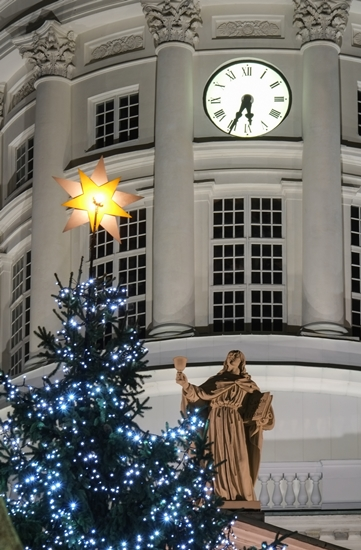 The star at the top of the Christmas tree on Senate Square stands out against the tower of the Lutheran Cathedral as St John looks on.