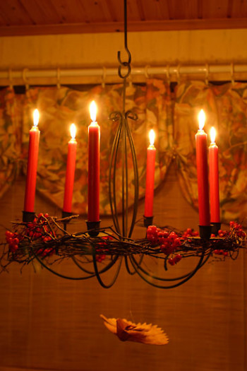 Christmas lights and candles ward off the dark of winter.
