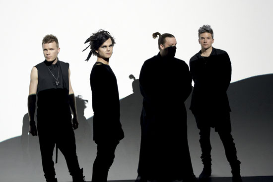 Members of The Rasmus pictured half in shade and half in the sunlight against a white background.