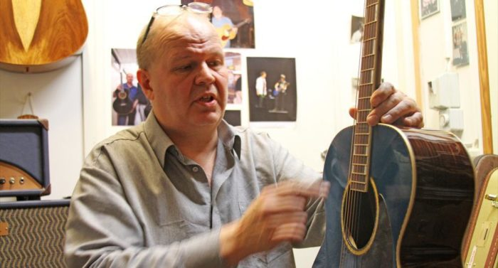 Guitar maker Kari Nieminen explains the finer points of one of his acoustic guitars.