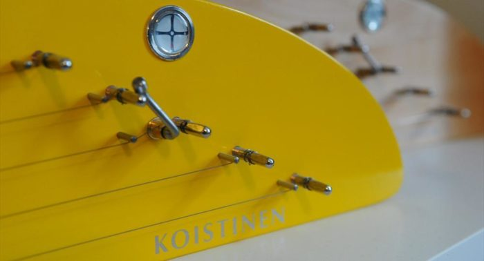 Koistinen close-up: The kantele strings are wrapped around metal tuning pegs.