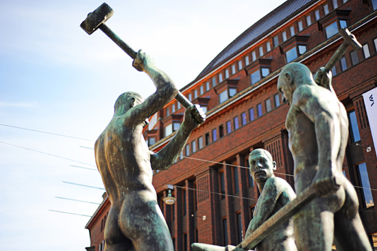 Three Smiths Statue (Felix Nylund 1938): A Helsinki icon, inspired by real people, the master smith's face is of poet Arvid Mörne, the one raising the hammer is a self-portrait of the artist Nylund, and third smith is of stonecutter Aku Nuutinen, Nylund's assistant. Photo: Emilia Kangasluoma