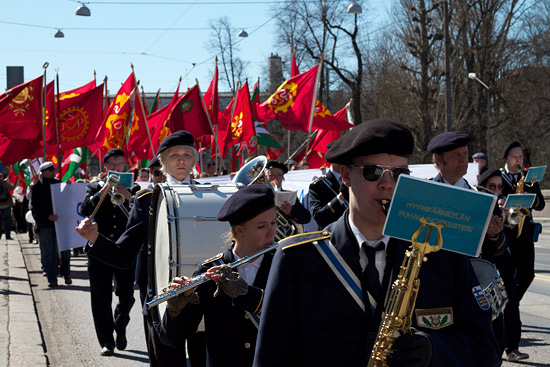 A parade headed by an orchestra.