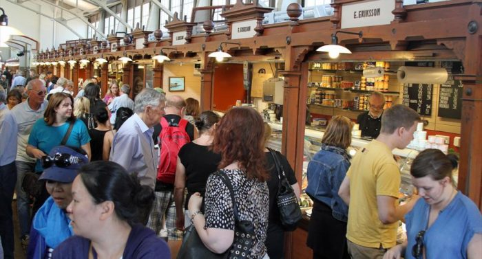 Helsinki's Old Market Hall, recently reopened after a year of renovation, attracts crowds of tourists and locals in search of Finnish food and goods.