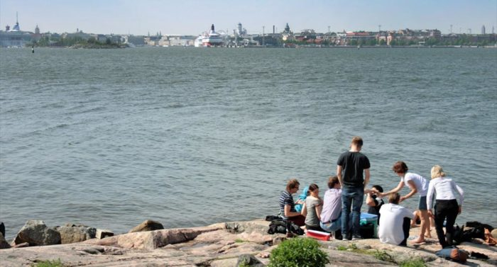A seaside picnic takes place against the backdrop of downtown Helsinki. Photo: Sabrina Salzano