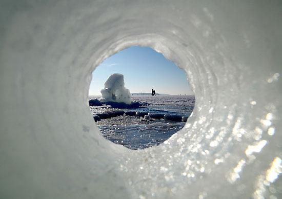 A fallen piece of an ice sculpture mimics a telescope. Photo: Tim Bird