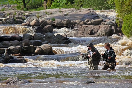 The rapids at Vanhakaupunki, where the river meets the sea, are popular with serious anglers and hopeful hook-danglers alike. Photo: Tim Bird
