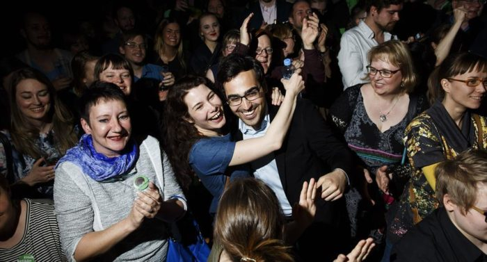 Emma Kari hugs Ozan Yanar (both Greens) as results come in showing that they have both won seats in Parliament. The Greens and the Centre were the only parties to increase their numbers of MPs this time.