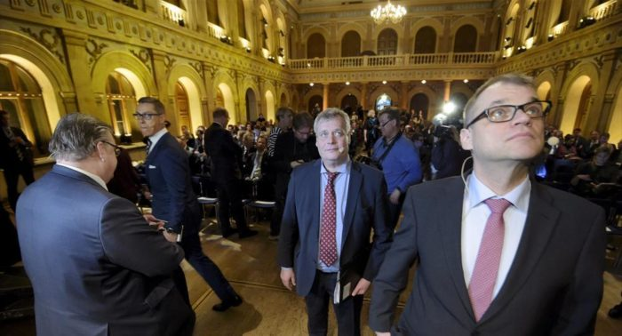 """In January 2015, party leaders Timo Soini (left, """"Finns"""" Party), Alexander Stubb (National Coalition), Antti Rinne (Social Democrats) and Juha Sipilä (Centre Party) gathered for a panel discussion held by the Federation of Finnish Industries."""