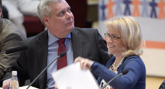 Christian Democratic Party chair Päivi Räsänen (right) and her Social Democratic counterpart Antti Rinne take their seats before a multiparty debate at Helsinki University in March 2015.
