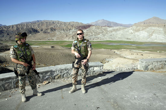 Participating in peacekeeping: Finnish soldiers in the International Security Assistance Force stand in front of the mountains of Afghanistan in 2006.