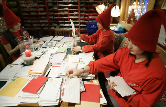 Elves help Santa sort and read letters from all over the world. Photo: Kacper Pempel/Lehtikuva