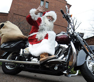 Cycle Santa Claus: Timo Alarik Pakkanen's Santa prepares to deliver presents by motorcycle.