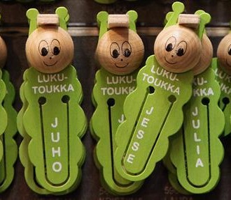 Caterpillar-shaped bookmarks with different names written on them.