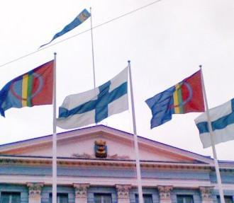 The Sámi and Finnish flags fly together outside Helsinki City Hall on Sámi National Day. Photo: Pirita Näkkäläjärvi