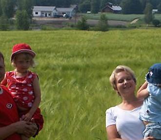 The farming family by their barley fields. Photo: Salla Korpela