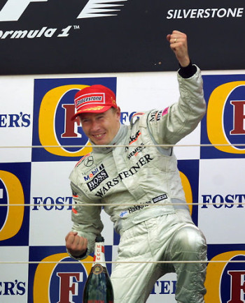 Mika Häkkinen celebrates on the podium after winning the 2001 British Grand Prix at Silverstone in 2001.