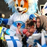 The team mascot parties with the fans.