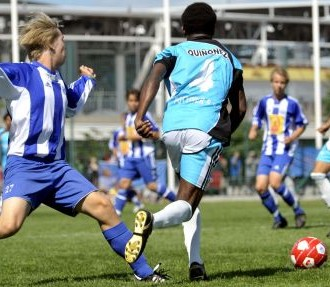 Hundreds of thousands of players from all over the world have participated in the Helsinki Cup over the years. Here Ecuadorian club UDJ Quininde (light blue) meets Helsinki's HJK (stripes).